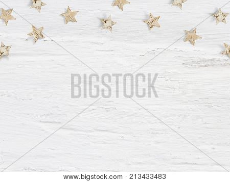 Christmas mockup scene little wooden stars made of birch bark on white grunge background, empty space for your text, top view flat lay photography.