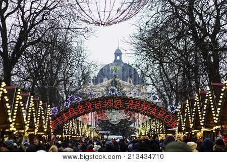 Christmas fair 2017 in Lvov on background of Christmas tree and Opera House