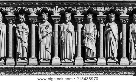 Architectural details of the catholic cathedral Notre Dame de Paris in black and white. Built in French Gothic architecture Notre-Dame's facade showing Gallery of Kings. Paris France