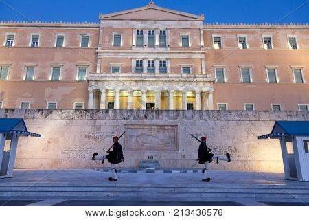 ATHENS GREECE - NOVEMBER 2 2017: Greek presidential guard Evzones parading in front of the Greek parliament on Syntagma square. The Evzoni are one of the symbols of Greece and of the Greek army