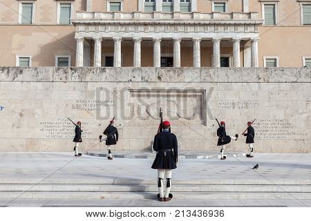 ATHENS GREECE - NOVEMBER 3 2017: Greek presidential guard Evzones parading in front of the Greek parliament on Syntagma square. The Evzoni are one of the symbols of Greece and of the Greek army
