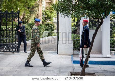 ATHENS GREECE - NOVEMBER 3 2017: Greek presidential guard Evzones parading in front of the Greek Presidential Palace. The Evzoni are one of the symbols of Greece and of the Greek army