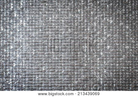 Aluminum heat shield close up background, beige, berber, blank