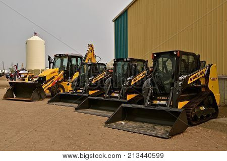 WEST FARGO, NORTH DAKOTA, September 21, 2017:  Displayed at the Big Iron show in West Fargo, North Dakota are a row of New Holland skid steers, held annually at the Red River Fairgrounds each September.