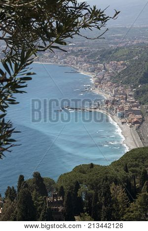Fabulous aerial view of Sicily and the Mediterranean Sea. On the coast you can see the small town of Villa Gonia and Giardini Naxos. Place where the photo was taken: Taormina, Sicily (Italy)