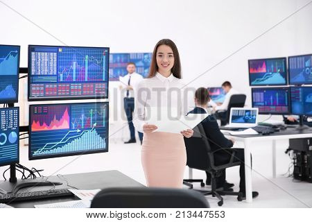 Female stock trader working in office