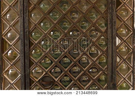 old wooden doors with glass inserts, Ancient wooden door close-up with round glass inserts