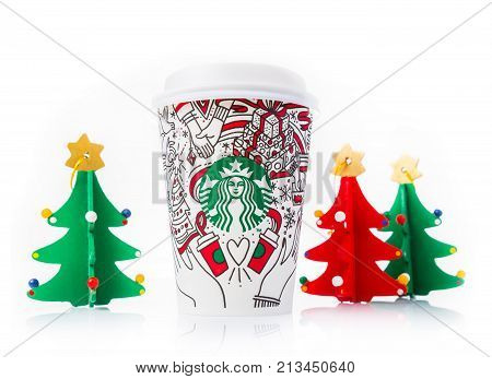 Chiang Mai Thailand- 11 November 2017 - Grande and Venti of Starbucks Coffee paper cups in beautiful 2017 Christmas design display on white background in Chiang Mai Thailand on November 11 2017
