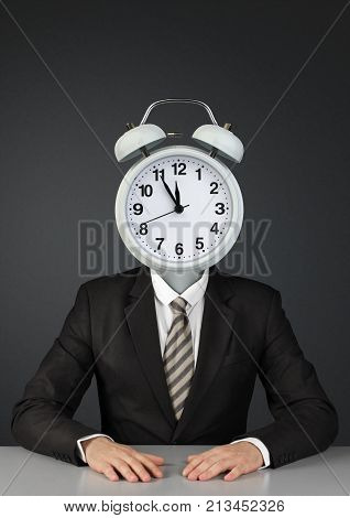 Businessman with ringing alarm clock instead of head, time limit concept