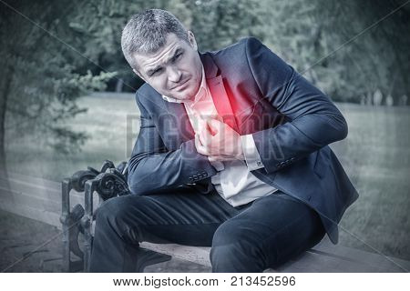 Businessman suffering from chest pain outdoors