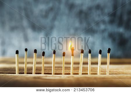 matches stand in a row one match burns. Concept of the idea. Top place for text