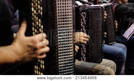 The musician playing the accordion. Close-up, musicians playing the accordion. Group of musicians playing the accordion.