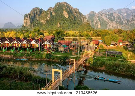 Row Of Tourist Bungalows Along Nam Song River In Vang Vieng, Vientiane Province, Laos