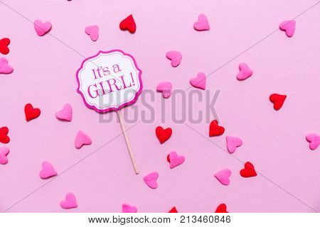 It's A Girl Sign At The Baby Shower Party.  Pink Solid Background.  Baby Shower Celebration Concept