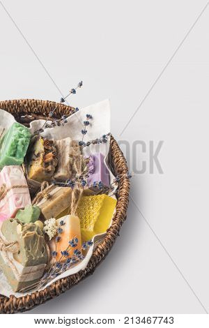 close-up shot of different handcrafted soap in bowl on white surface poster