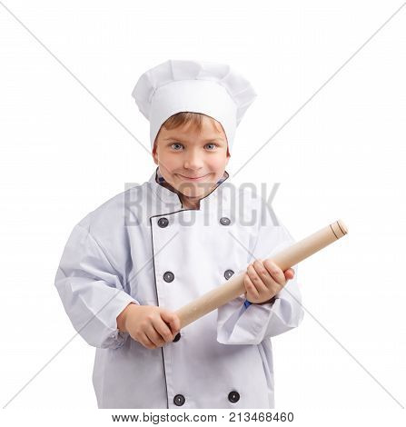 Little cook in a white cap with a smile holds a rolling pin on a white isolated background