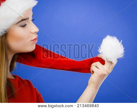 Woman Wearing Santa Claus Helper Costume Holding Pompon