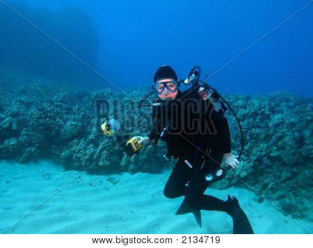 A Scuba Diver And Underwater Photographer In Maui Hawaii