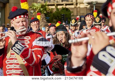 Soldiers Playing Flute And Bagpipe In Tamborrada Of San Sebastian. Basque Country, Spain.