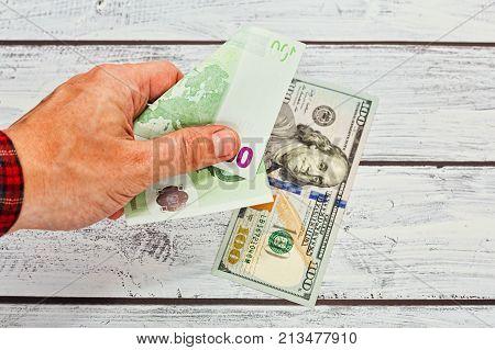 Person Changing 50 Euros To 100 Dollars