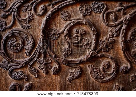 Beautiful texture of wooden wrought and decorated door in medieval european style. Medieval architecture concept