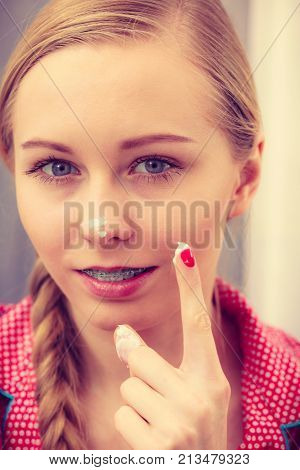 Woman Applying Moisturizing Skin Cream. Skincare.