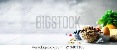 Homemade granola with milk, fresh berries, milk for breakfast. Copy space. Healthy breakfast concept. Banner