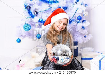 Girl With Happy Face Near White And Blue Christmas Tree