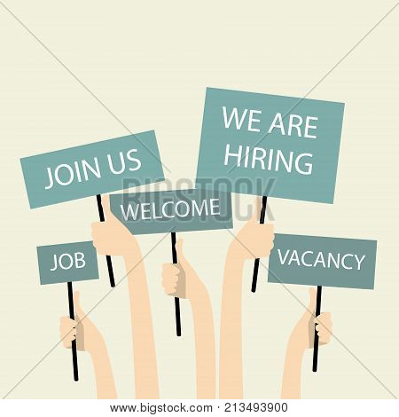 We are hiring. Hands holding posters with vacancy and join us.
