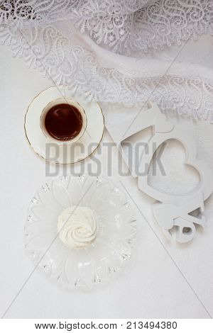 Zephyr cup of coffe. Top view of coffee zephyr on white background