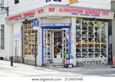 Brussels Belgium - April 2015: Local grocery selling food tobacco and alcoholic drinks in Brussels Belgium