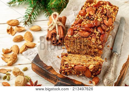 Festive Homemade Holiday Fruitcake With Nuts, Fruit And Spices. Almonds, Cinnamon, Star Anise, Carda
