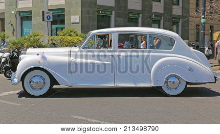 NAPLES ITALY - JUNE 22 2014: White Rolls Royce Luxury Wedding Car in Napoli Italy.