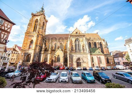 COLMAR, FRANCE - July 26, 2017: View on the saint Martins cathedral in the center of Colmar town during the sunny weather in Alsace region, France