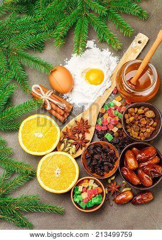 Prepare A Fruitcake. The Ingredients On The Table - Dark And Light Raisins, Dates, Flour, Eggs, Hone