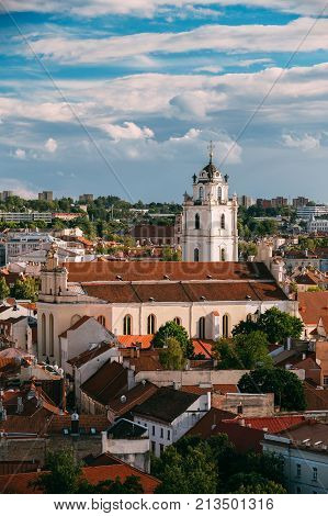 Vilnius, Lithuania. View Of Bell Tower And Church Of St. Johns, St. John The Baptist And St. John The Apostle And Evangelist In Old Town.