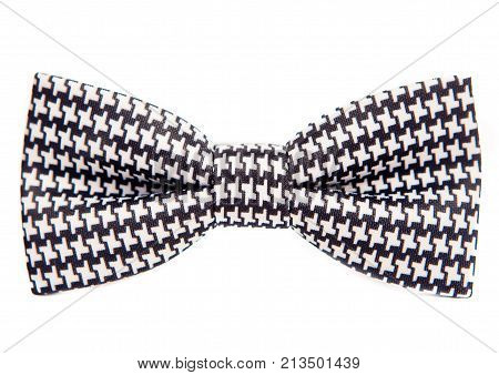 Bow tie with unusual cells on a white background. Equipment subsidiary for formal dress. The symbol of elegance and fashion for men. Bow Tie man. Men and women accessories.Hipster style.