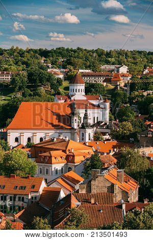 Vilnius, Lithuania. View Of Cathedral Of Theotokos And Church Of St. Johns, St. John Baptist And St. John Apostle And Evangelist In Summer Day.
