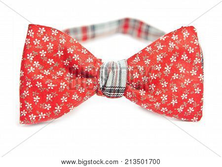 Red bow tie in flower pattern, close up, hipster style.