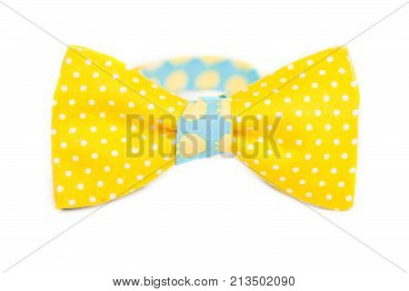 yellow tie bow with white polka dots.