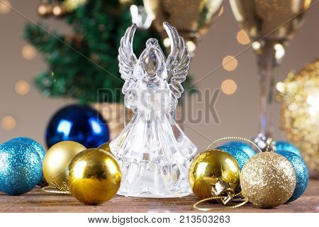 Crystal Angel on the background of Christmas balls. new Year decoration. Christmas ornaments christmas decoration