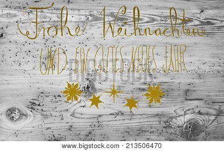 Golden German Calligraphy Frohe Weihnachten Und Ein Gutes Neues Jahr Means Merry Christmas And Happy New Year. Gray Vintage Wooden Background
