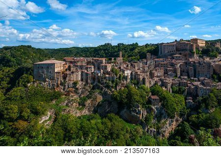 Classic panoramic view of the ancient town of Sorano an ancient medieval hill town hanging from a tuff stone over the Lente River. province of Grosseto southern Tuscany Italy