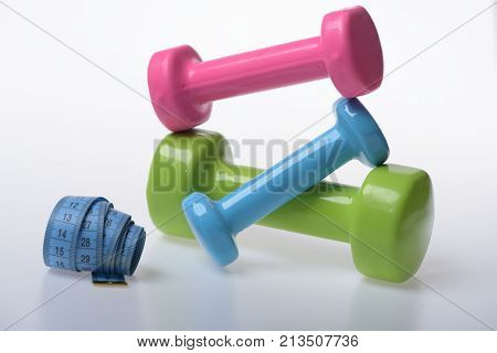 Measure Tape And Pink, Green And Blue Barbells