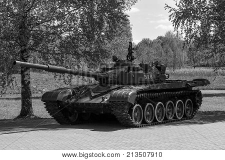 Russian tank shows for tourists in the open air. black-and-white photograph. military equipment.