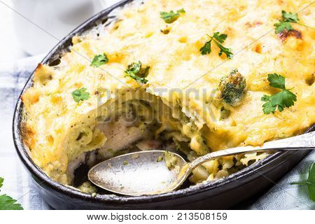 Gratin or Casserole from fish pasta broccoli and cheese in bechamel sause. Close up.
