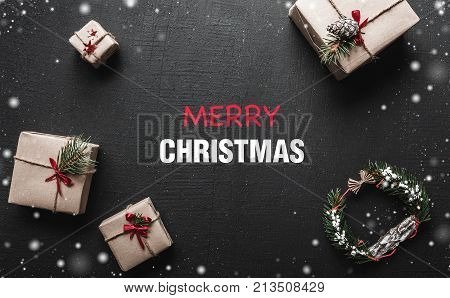 Christmas card. With a congratulatory message for loved ones. Gifts that are waiting for children. Xmas ambience is filled with gorgeous gifts and charm of snowflakes