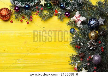 Christmas Decorations On Yellow Wooden Texture Background