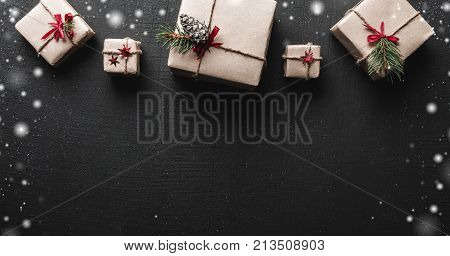 Christmas card. Symmetrically arranged gifts at the top of the image. Space for Christmas greeting message. Xmas ambience is complemented by gorgeous gifts and snowflakes