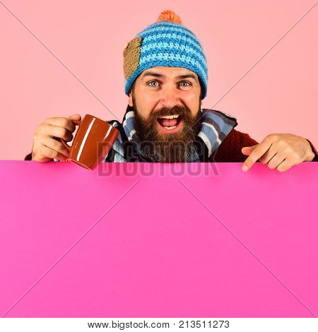 Hipster With Beard And Excited Face Has Tea Or Coffee